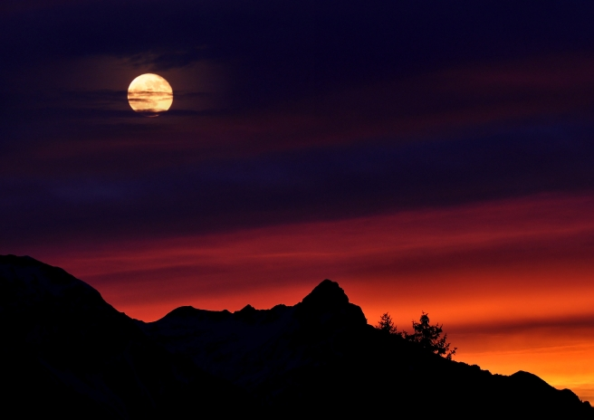 Blog Post Picture 10.13.19 Moon at sunset over the mountains