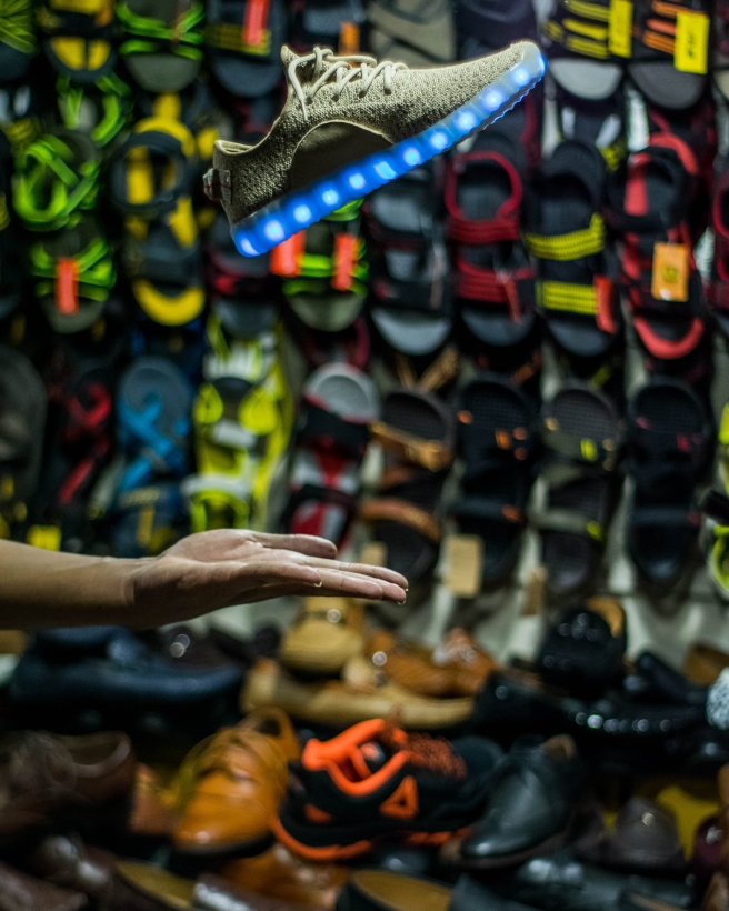 Blog Psot Picture 11.4.19 Person tossing a shoe in a shoestore